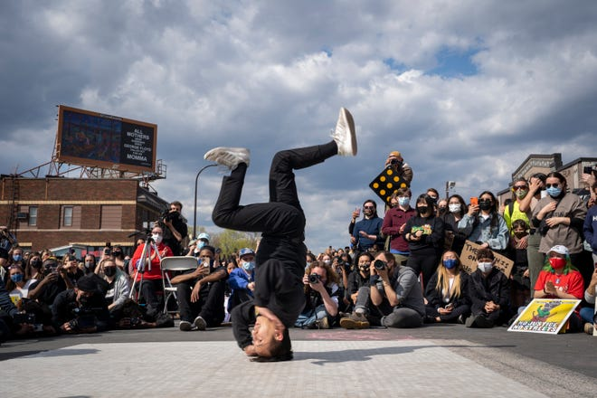 A member of the Cypher Side dance troupe breakdances during the Asian & Black solidarity rally on April 18, 2021.