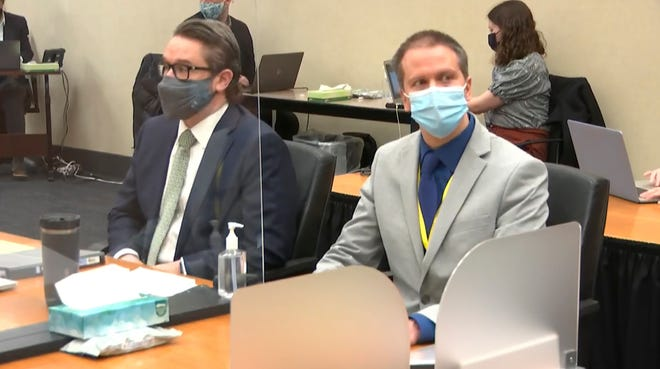 In this image from video, defense attorney Eric Nelson, left, and defendant, former Minneapolis police officer Derek Chauvin listen to Hennepin County Judge Peter Cahill read instructions to the jury before closing arguments, Monday, April 19, 2021.