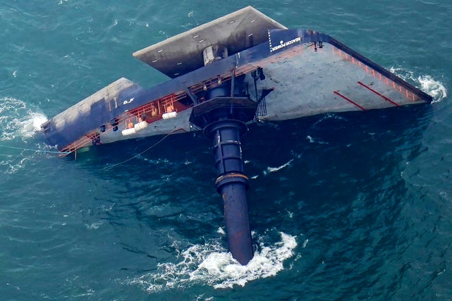 The capsized lift boat Seacor Power is pictured April 18 about 8 miles off Port Fourchon.