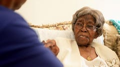 """This Aug. 13, 2016, file photo shows Roosevelt Patterson greeting his grandmother Hester """"Granny"""" Ford during Ford's 111th birthday party. Ford was either 115 or 116 years old depending on which census report was accurate. Either way, she was the oldest living American when she died Saturday, April 17, 2021, in Charlotte, according to the Gerontology Research Group, which tracks """"supercentenarians."""" They listed her age as 115 years and 245 days."""
