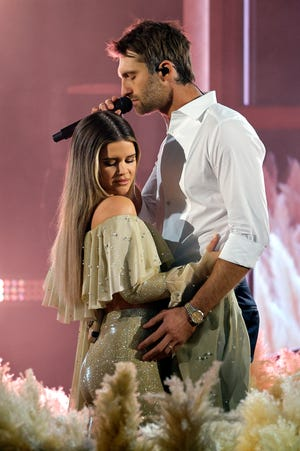 Maren Morris, left, and Ryan Heard performed on stage at the 56th Academy Country Music Awards on April 18.