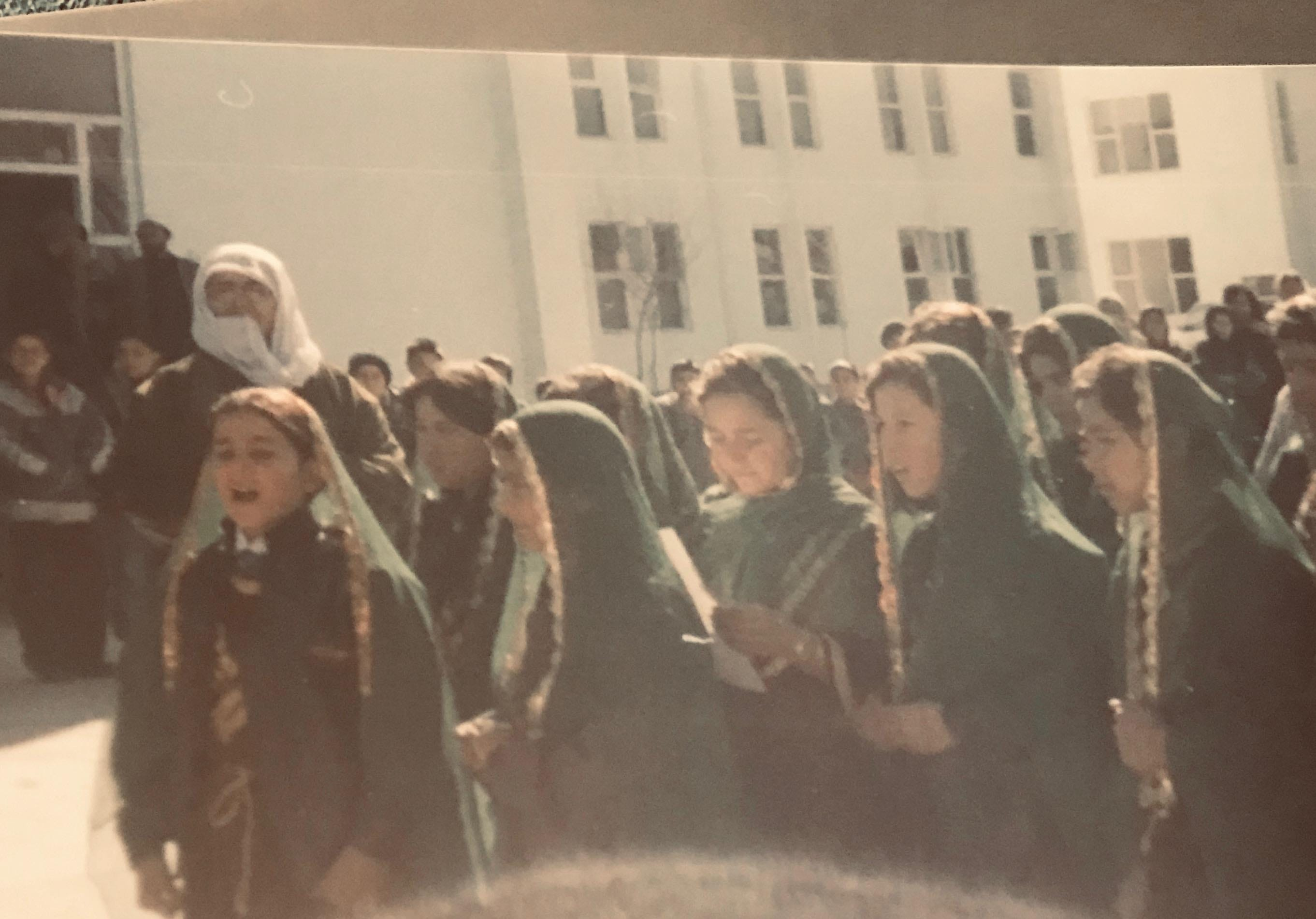 Zarifa Hamidi, center with white paper, at an orphanage in Afghanistan in the 2000s.