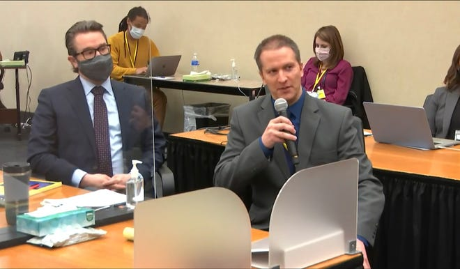 Defense attorney Eric Nelson (left) and former Minneapolis police officer Derek Chauvin are pictured addressing Hennepin County Judge PeterCahill. Chauvin is charged with second-degree murder, third-degree murder and second-degree manslaughter in the death of George Floyd last Memorial Day.