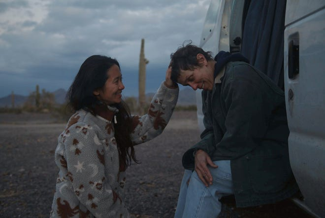 """Director Chloé Zhao, left, appears with actress Frances McDormand on the set of """"Nomadland."""""""