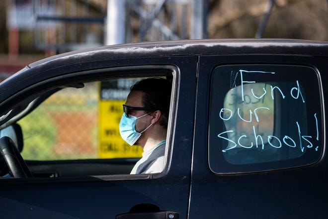 Justin Erwin gathered with other teachers on Monday morning, March 15, 2021, at Austin High School as they prepare to drive to and around the Texas governor's Mansion in Downtown Austin in support of funding for education, teacher pay, and vaccines.