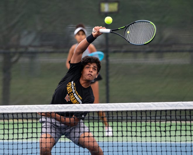 Rohith Gajjala of Westwood makes a return during the mixed doubles final. Gajjala teamed with Gina Mepham to finish second at the District 25-6A tennis championships April 14-15 at Old Settlers Park in Round Rock and qualify for the regional tournament.