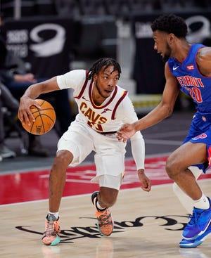 Cavaliers guard Darius Garland (10) controls the ball against Detroit Pistons guard Josh Jackson (20) during the Pistons' 109-105 win Monday night. [Carlos Osorio/Associated Press]