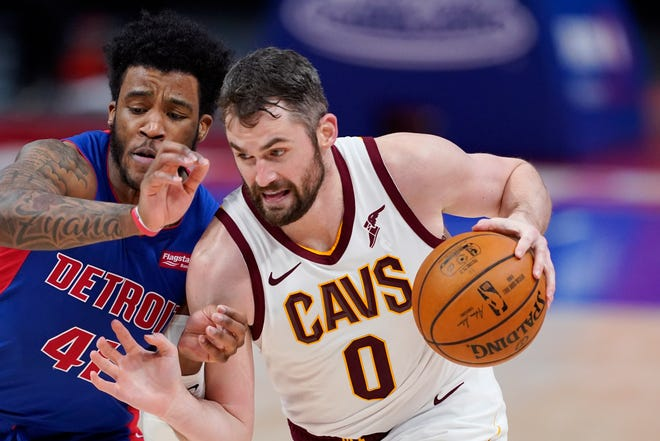 Cavaliers forward Kevin Love (0) drives as Detroit Pistons forward Saddiq Bey defends during the Cavs' 109-105 loss Monday night in Detroit. [Carlos Osorio/Associated Press]