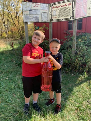 Intrigued by the story of Kate Shelley, local students Miles Sitterle, left, and Sam Davidson are raising funds for the park that honors her. The historical society will hold a clean-up day at the Kate Shelley Park from 9 a.m. to noon on May 8.