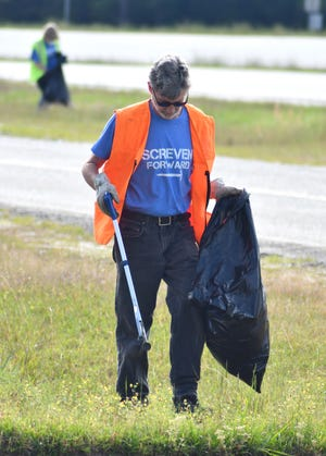 Members of Screven Forward pick up trash along Frontage Road in Sylvania.