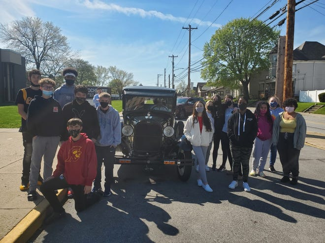 Members of Jason Russo's ninth-grade American history class at Rochester High School learning about the 1920s, Henry Ford and the rise of the automotive industry had the opportunity Monday to see a vehicle from the era in person. Carmen Venezie of Ellwood City brought his 1929 Ford Model A truck to the school.