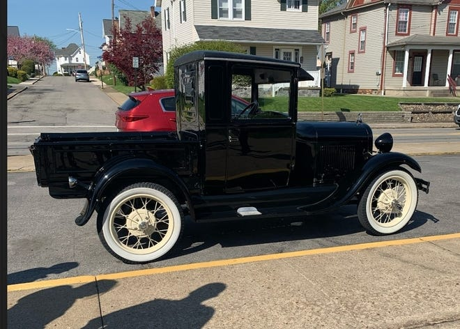 Carmen Venezie of Ellwood City brought his 1929 Ford Model A truck to Rochester High School Monday for Jason Russo's ninth-grade American history class. Students are learning about the 1920s, Henry Ford and the rise of the automotive industry.