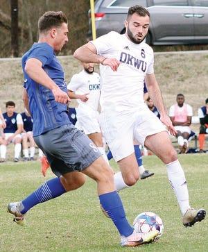 Oklahoma Wesleyan University's Alexandre Lebrisse, right, battles to possess the ball.