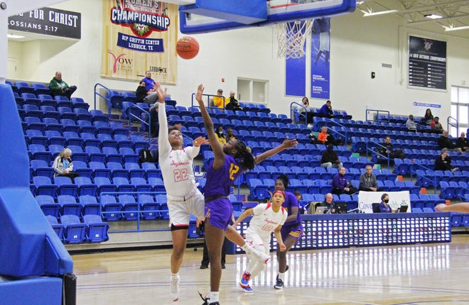 Moberly Area's NJ Weems (22) attempts a shot against Eastern Arizona's Ajae Yoakum (12) in the first round of the NJCAA women's national tournament in the Rip Griffin Center on the campus of Lubbock Christian University on Tuesday, April 20.