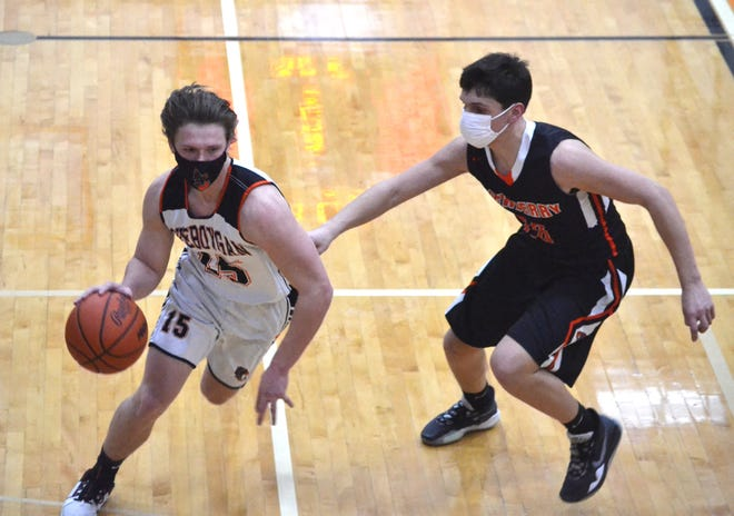 Cheboygan junior Henry Stempky (left) recently earned a spot on the All-Straits Area Conference boys basketball first team.