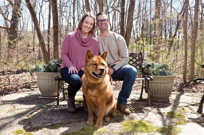 Geoff and Lauren Kunkler with their 9-year old chow mix, Mowgli.