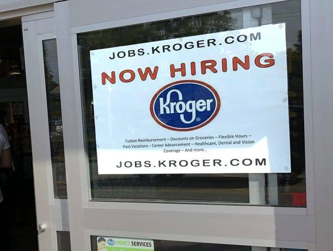 A hiring sign hangs in front of a Kroger's grocery store in Hilton Head, S.C., in 2018.