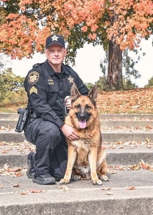 K-9 officer Vando, seen with his partner, Franklin County Sheriff's office Sgt. Aaron Heflin, died unexpectedly Monday night. Vando was a 9-year-old German Shepherd and was due to retire in the near future.