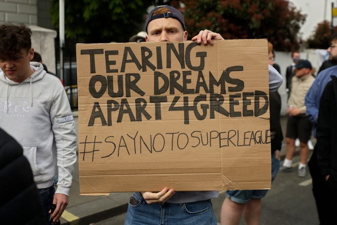 Fans gather outside Stamford Bridge stadium in London on Tuesday to protest Chelsea's decision to be included among the clubs attempting to form a new European Super League.
