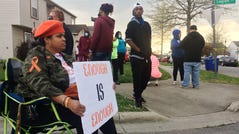 Malisa Thomas-St. Clair, with Mothers of Murdered Columbus Children, sits outside the scene of a police shooting near Legion Lane on Columbus' Southeast Side.
