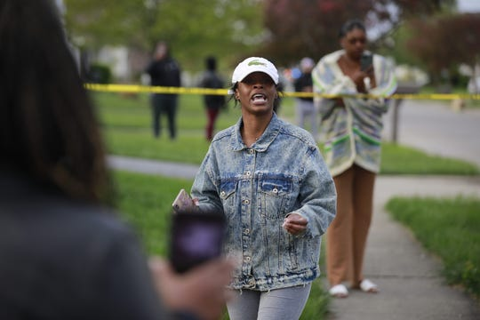 Shanise Washington talks to the crowd that had gathered following a fatal police shooting on Tuesday, April 20, 2021 near Legion Lane on the east side of Columbus, Ohio.