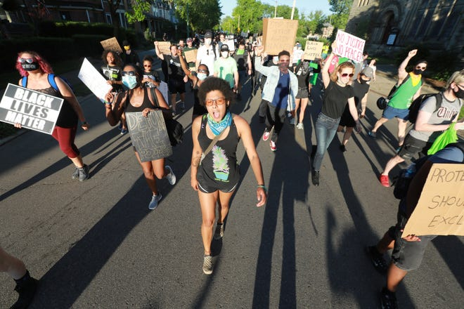 George Floyd protesters move through the Near East Side Saturday, June 6, 2020 in Columbus, Ohio.  (Doral Chenoweth/Columbus Dispatch)