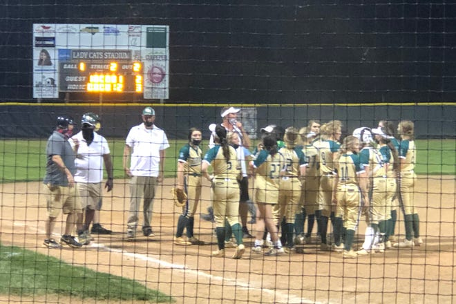 Eastern Randolph's softball team celebrates after a 3-2 win over Providence Grove. [Cecil Mock for The Courier-Tribune]