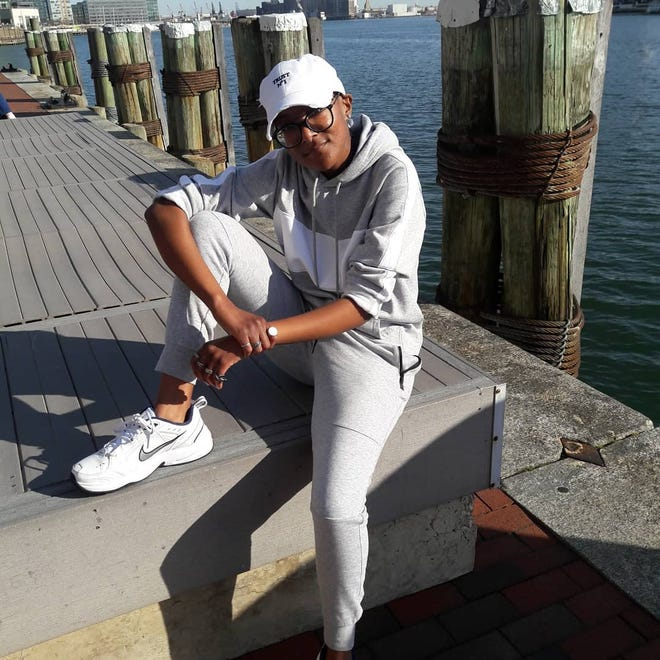 Courier-Tribune writer Petruce Jean-Charles enjoys the view at the Baltimore Inner Harbor.