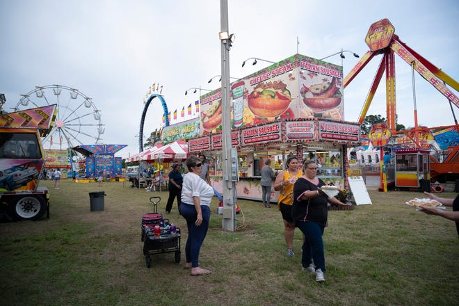 People walk through the midway at the Lake County Fair on Thursday. [Cindy Peterson/Correspondent]