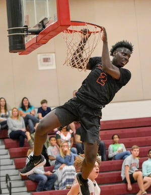 Leesburg's Lance Erving (2) dunks against Tavares during a 2017 game in Tavares. Erving recently helped Chipola College to the National Junior College Athletic Association national championship tournament. [PAUL RYAN / CORRESPONDENT]
