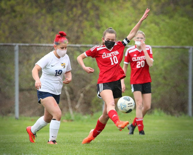Clinton's Sky Chandler kicks the ball ahead during Monday's game against Hillsdale.