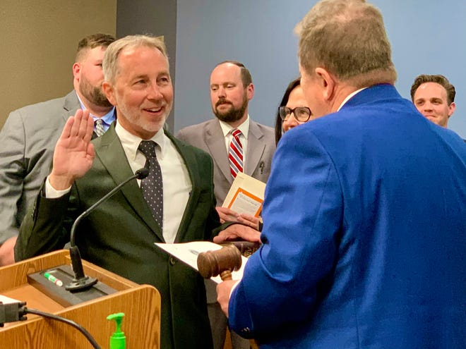Newly-elected Mayor Jim Hagaman is officially sworn in by outgoing Mayor Rick Graham at Spring Hill City Hall on Monday, April 19, 2021.