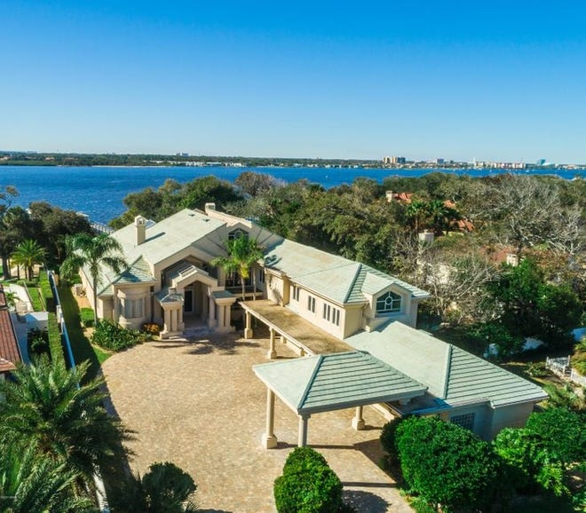 This Daytona Beach beauty, nestled on one-and-a-half acres, with 111 feet on the Intracoastal Waterway, is a block from the ocean and minutes from the inlet.