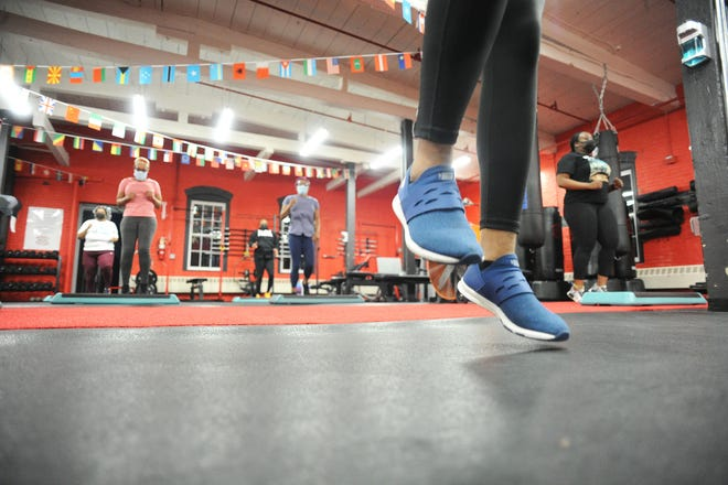 Personal trainer Fabiola Garcon of Brockton leads a step dance class at Body Prime Fitness in Canton, Monday, April  19, 2021.