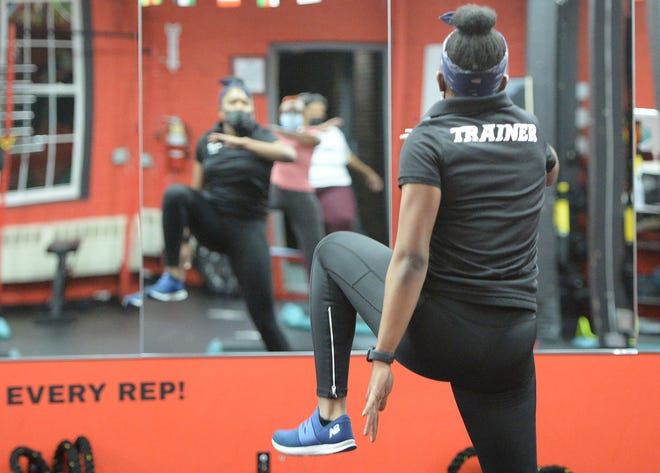 Personal trainer Fabiola Garcon of Brockton, leads a step dance class at Body Prime Fitness in Canton, Monday, April  19, 2021.