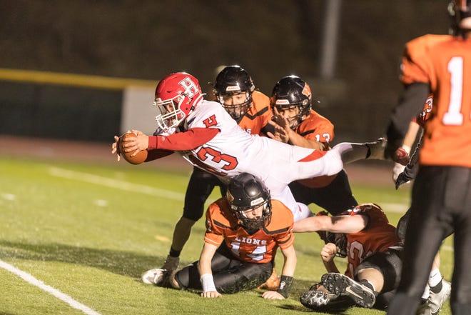Hornell's Brennan Khork flies over the goal line for a touchdown during Monday's win over Wellsville.