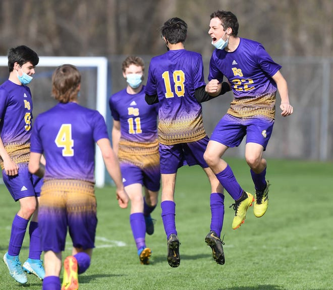 Richfield Springs Indians Damon Thomson (18) and Brady Young (22) celebrate a goal during Monday's match against Worcester.