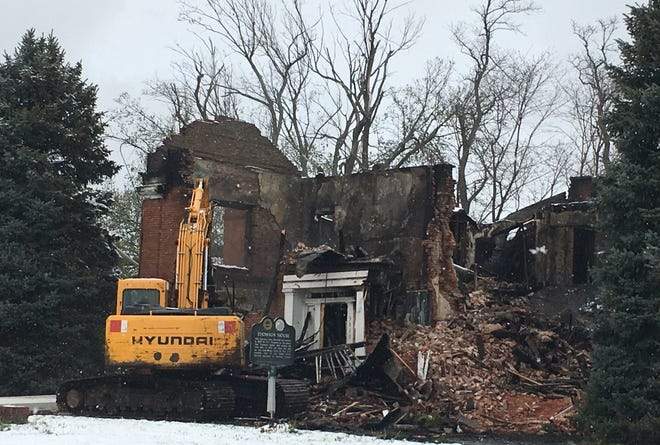 Demolition started Tuesday on the Thomson House on U.S. 40. The building, constructed in the 1850s, suffered its third fire in nine months Monday and was deemed a dangerous structure as a public health risk.