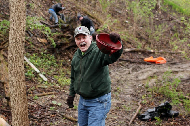 Randy Miller hams it up as volunteers pick up trash during the 11th annual Earth Day Cleanup event April 16, 2011, in Burlington. This year's Earth Day cleanup will start at 8 a.m. Saturday at Westland Mall in West Burlington. A Celebration of Life for Miller will take place later in the day from 2:30 to 4:30 p.m. at the Perkins Park shelter house in Burlington.