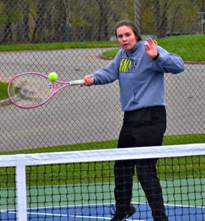Burlington High School's Jessica Kendell returns a serve from Keokuk's Jasmine Saunders in the No. 2 singles match at Dankwardt Park Monday. Kendell won, 8-3.