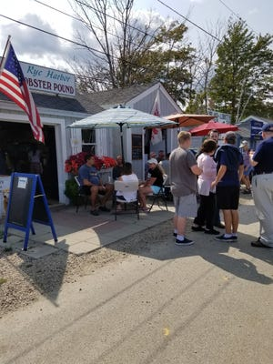 The owners of Rye Harbor Lobster Pound, seen on a busy summer day, had been told the business could no longer operate at the location. On Tuesday, the business received a one-year waiver from Gov. Chris Sununu.