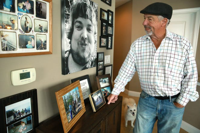 Joe Kenney shows a wall of his Jacksonville condominium decorated with photos of his son Gary, who suffered from depression and committed suicide at age 30. The sense of helplessness that Kenney felt when dealing with his son's depression led him to fund Here Tomorrow, a Neptune Beach-based group that tries to get immediate help for those who need it.