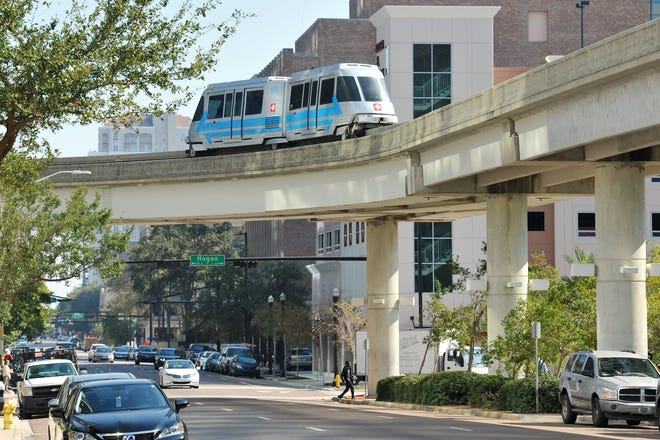 The Skyway trains travel through downtown Jacksonville on a 2.5 mile elevated structure. A plan by the Jacksonville Transportation Authority would keep that elevated structure but convert it for use by rubber-tired autonomous vehicles that could carry riders as well on street-level routes as part of a 10-mile transit network. A local gas tax increase would pay the conversion.