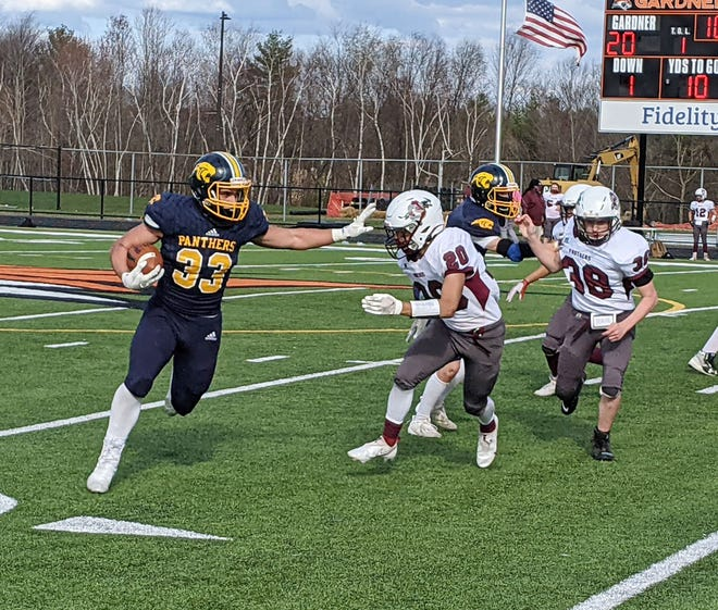 Quabbin fullback Owen Faulha finds plenty of room to run on the outside against Ayer-Shirley's Gabe da Costa (20) during Monday's game at Watkins Field in Gardner. Faulha rushed for 171 yards in Quabbin's 48-35 win.