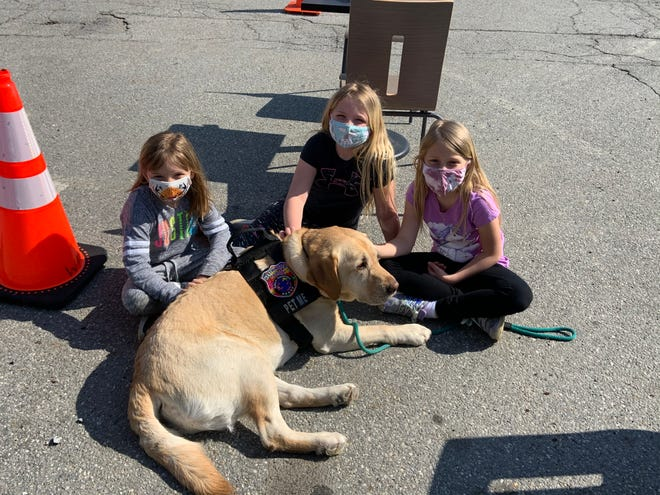 Enjoying a visit from K9 Merle at the Westminster Police Department's Coffee with a Cop event on April 20 are, from left, Mackenzie Breau, 6, Meya Duval, 8, and Chelsea Breau, 8.