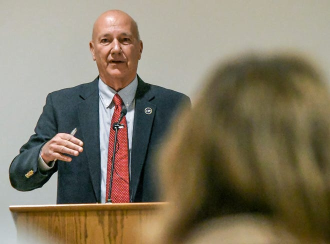 Rep. Russ Jennings talks about budget funding Saturday during a Garden City Area Chamber of Commerce legislative coffee at Garden City Community College.