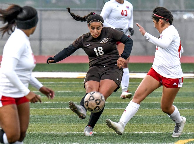 Garden City High School's Wendy Zamudio, center, moves the ball upfield to a teammate April 15 against Dodge City at Buffalo Stadium.