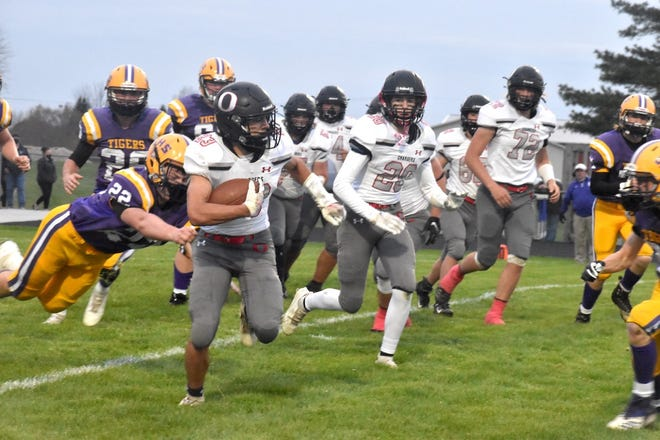 Charger Cole Kratzberg (23), far left, runs for a first down early in the second quarter of the varsity game with the Tigers on Friday, April 16, in Sherrard. Also in on the play are, in front from left, Blayden Murdock (20) and Jayson Johnson (72), and in back Kale Stropes (57) and Nolan Loete (62).