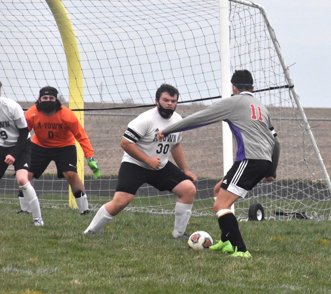 Orion-Sherrard's Kade Helm, right, attacks the goal during a varsity match on Wednesday, April 14, with Abingdon-Avon at Charger Field