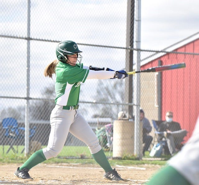 Natalie Baumgardner hits a homerun in the Geneseo and Orion softball game which Geneseo won – 13-0.